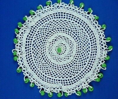 VINTAGE  GREEN GLASS  BEADED JUG COVER 18 cms WITH WHITE CROCHETED BODY
