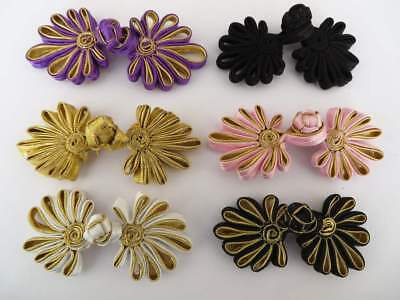 2 sets of hand-stitched frog fasteners trims, choice of colours with gold.