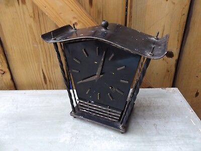 vintage black metal clock made in england wind up, with key and pendulum