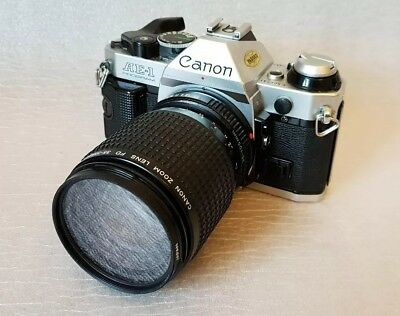 Canon AE1 Program SLR 35mm Film Camera With Canon 35-105mm 1:3.5-4.5 Zoom Lens.