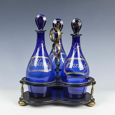 Three Bristol Blue Club Decanters With Brass and Laquered Frame c1820