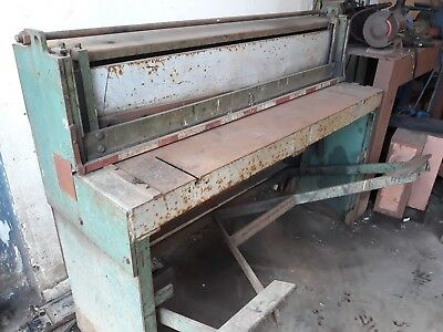 Sheet metal guillotine