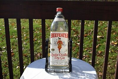 Vintage Beefeater Empty Dry Gin Bottle On Black Metal Swing Stand One Gallon