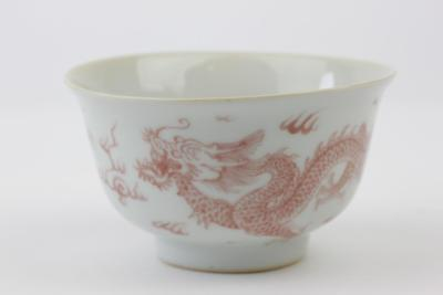 Chinese Porcelain Bowl With Under Glaze Red Dragon's Against A  White Ground