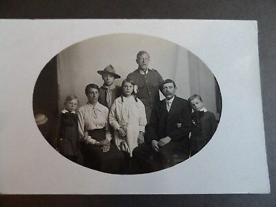 boy scout with family  postcard real photograph social history