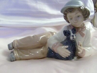 LLADRO/NAO Young Boy laying down with his Puppy