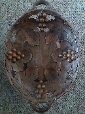 Antique hand carved swiss music box dish with grapes and vine leaves.