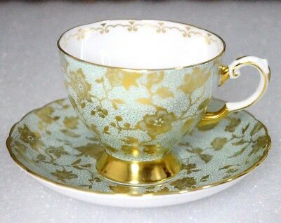 A Gold Pattern Flowers on Light Blue Background Tuscan England Cup Saucer Set