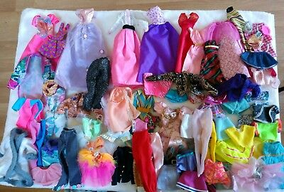 Large lot and variety of Barbie clothes all in very good clean condition #C