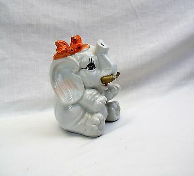 Vintage Elephant Bank 1950s porcelain animal figurine with orange Bow 5.5""
