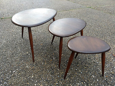 Beautiful nest of 3 Ercol pebble coffee tables.