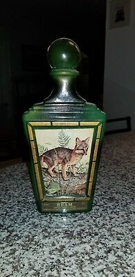 Antique Glass Beam Bourbon Whiskey Bottle with a picture of gray fox