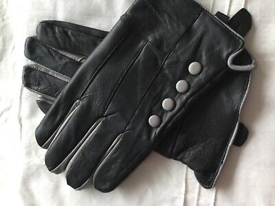 Ladies black gloves with grey trim. Very soft leather. Warm and elegant. Size L