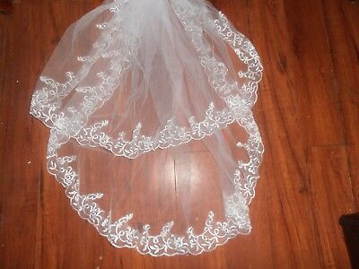 Two tier white bridal veil with lace edging and comb