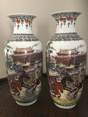Antique Pair of Marked Chinese Porcelain Vaces Depicting Fighting Warriors