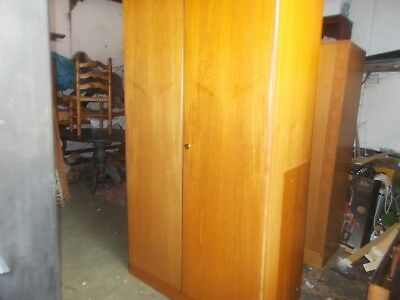 A Matching Pair Of Vintage Stag Double Wardrobes