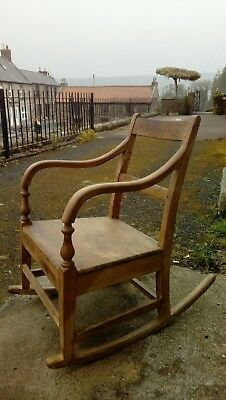Arts & Crafts oak Rocking Chair. C 1900