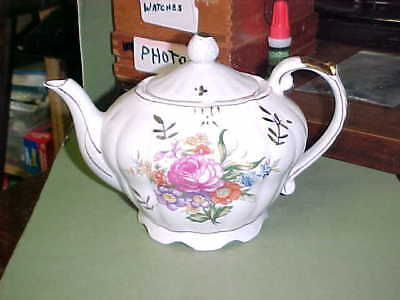 "JAPANESE MUSICAL TEAPOT w.FLORAL PATTERNS ON BOTH SIDES / ""JAPAN""<NR>"