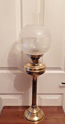 A vintage brass oil lamp with frosted shade Duplex twin burner working order