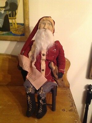 Arnett's Country Store Primitive Santa In Chair
