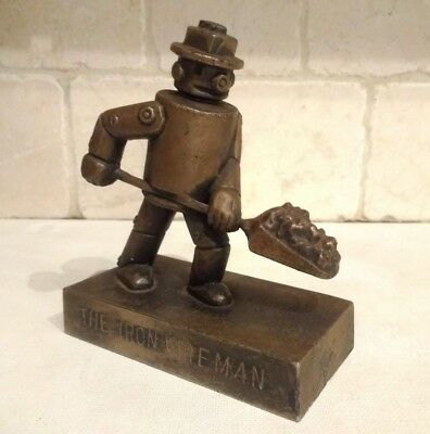 Vintage 'The Iron Fireman Robot' Metal Base Advertising Paperweight Deco Tin Man