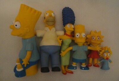 Stocking stuffers!  Simpsons family (bendables) & Bart Simpson coin bank