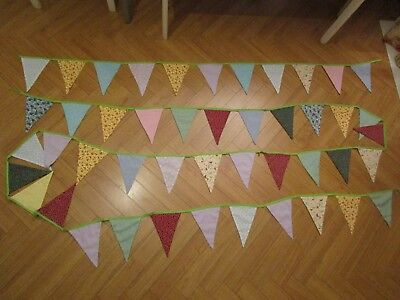 Cloth hand made bunting varied colored fabrics suitable for childrens room