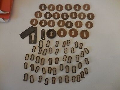 Lot of 73 antique furniture wooden key hole covers and brass lock inserts