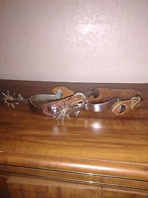 Vintage Crockett spurs with heart rowel pins