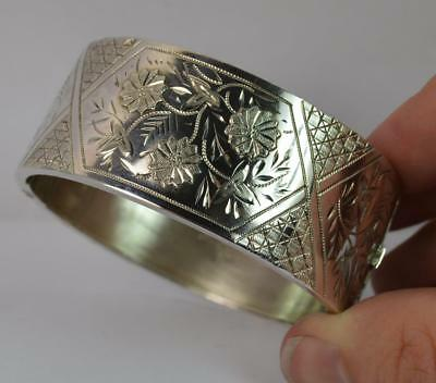 Large 1884 Victorian Aesthetic Movement Solid Silver Bangle with Flower Pattern