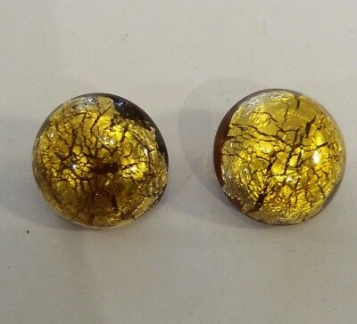 a vintage pair of clip on earrings . Glass Amber coloured and gold tone