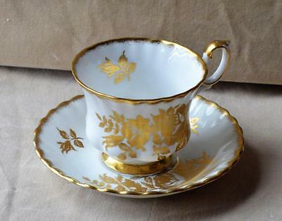 Vintage ROYAL ALBERT Bone China England GOLDEN ROSE Set Footed Cup & Saucer