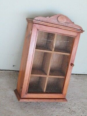 Wooden wall cabinet or spice rack with wire mesh door