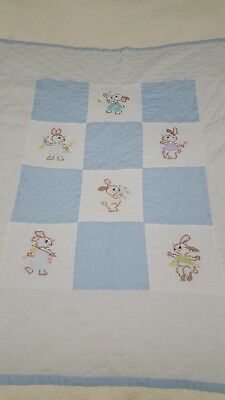 baby quilt blue and white embroidered bunnys