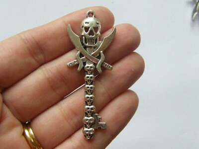 2 Skull pendants antique silver tone HC72