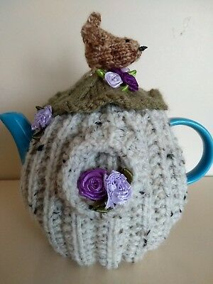 Hand-knitted birdhouse tea cosy with wren&flowers. Great gift for birdwatchers