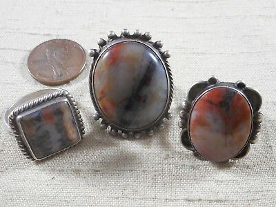 Collection of 3 FRED HARVEY era Navajo rings with petrified wood stones
