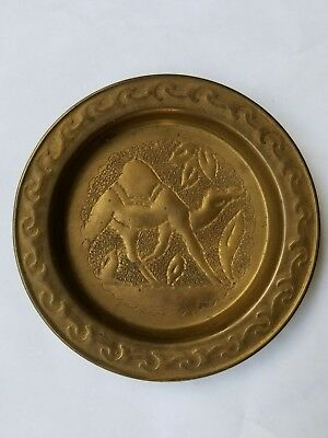 Antique brass camel coaster scrolling around edge early 1900s era 4 inches wide