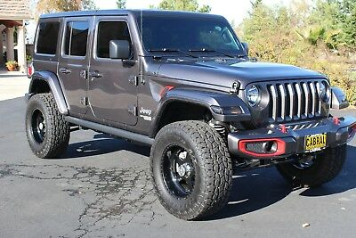 2018 Jeep Wrangler Custom Unlimited Sport Utility 4-Door 2018 Sport Used 3.6L V6 24V Automatic 4WD SUV