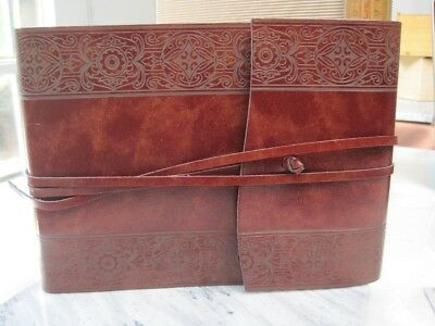 Paper sheets, photo album with a brown leather cover JMF013
