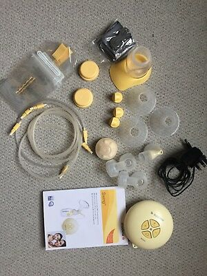 Medela Swing Electric 2 Phase Breast Pump with bottle and spare storage bags