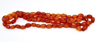 A Wonderful String of Vintage Faceted Amber Bead Necklace  #11207