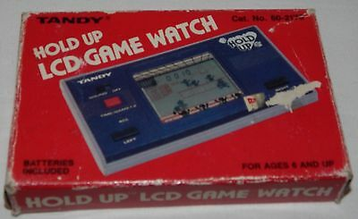 **VINTAGE HOLD UP LCD HANDHELD ELECTRONIC GAME WATCH BY TANDY IN BOX/BOXED**/g&w