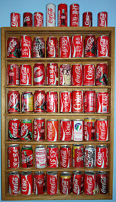 Vintage Coke Can and Bottle Collection