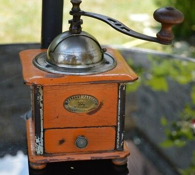 A Vintage French Peugeot Freres wood and metal orange painted Coffee Grinder