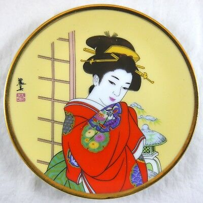 Japanese Hand Painted Geisha in Red Porcelain Plate w Gold Trim. Artist Signed