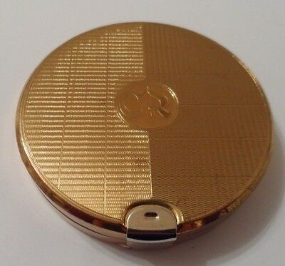 Vintage 'CHARLES OF THE RITZ'  powder compact in gold toned engine turned metal.