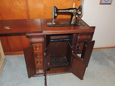 Antique Singer Treadle Sewing Machine In Cabinet