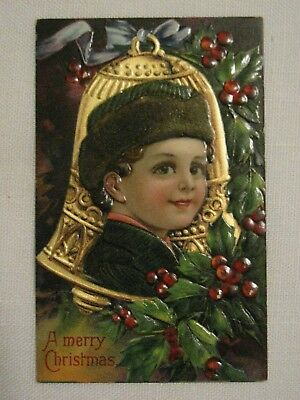Child with brown hair inside of large bell~ Vintage christmas postcard c1910