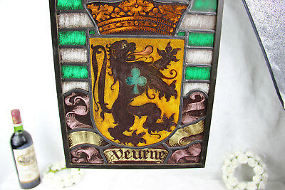 Old Flemish stained glass window symbol escutcheon city of Veurne lion